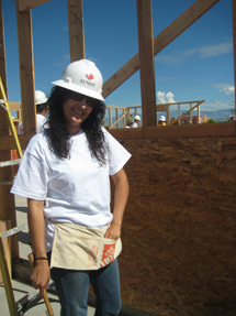 claudia-acosta-pounds-nails-on-her-habitat-home-at-building