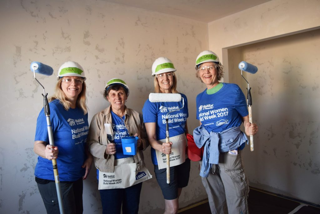 a group of habitat volunteers at a build site